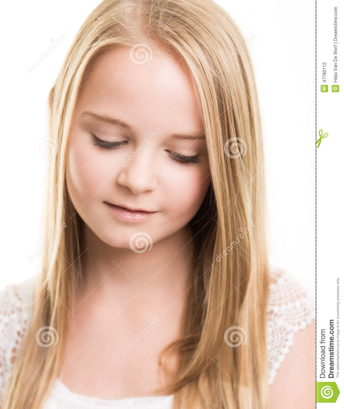 blond young teenage girl dressed in white in the studio stock