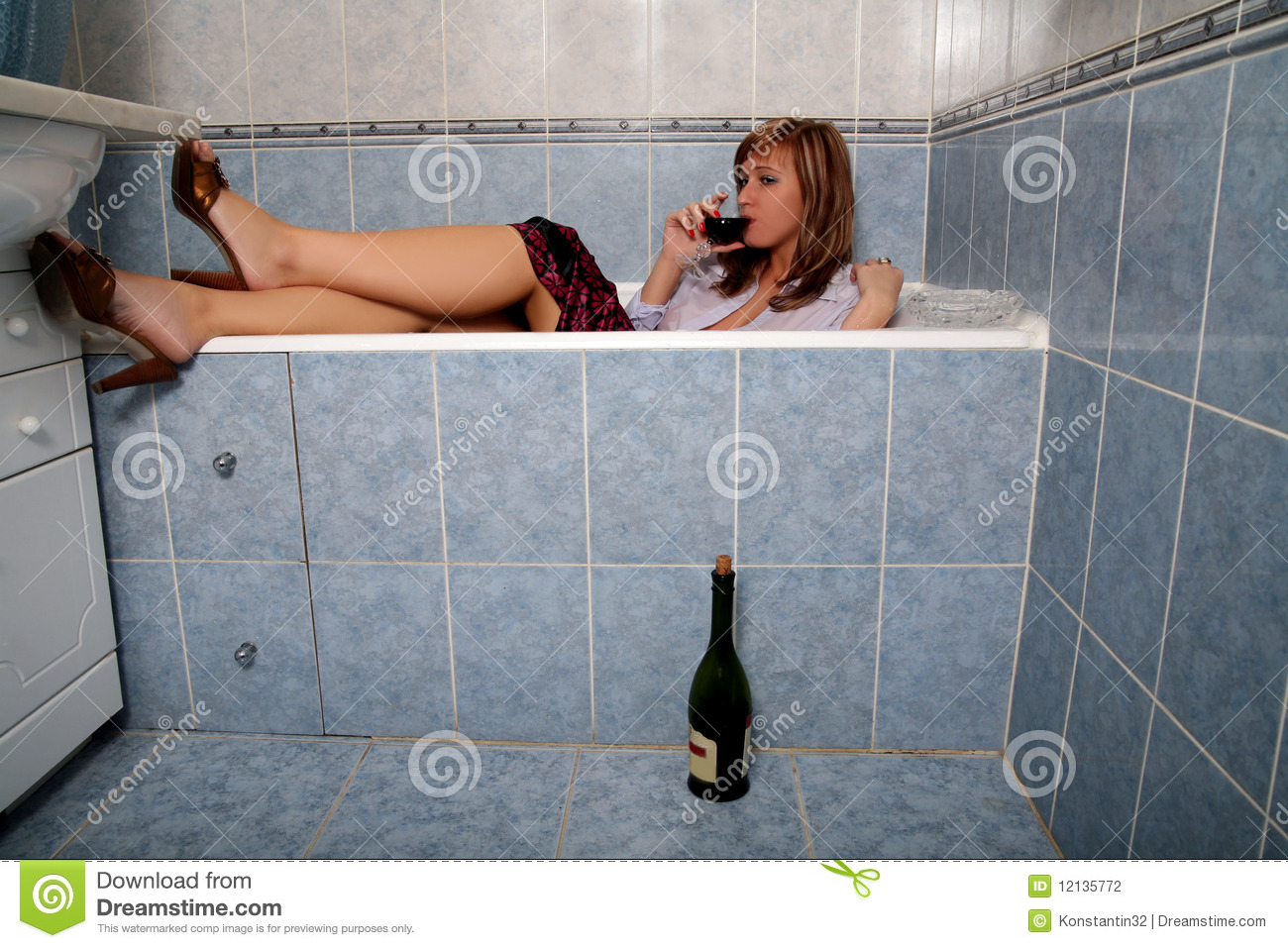 Photos Of Girl Without Any Cloth In Bathroom - Blonde in bathroom in clothes with wine stock photography