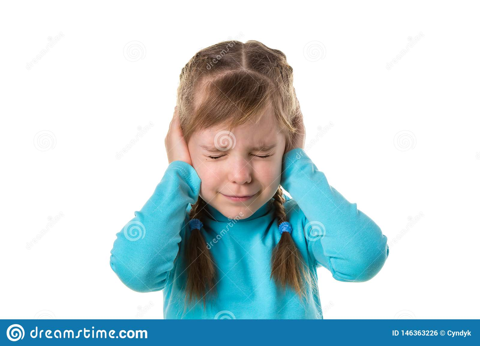 Blonde caucasian young girl closing ears with hands, suffering from noise. Isolated over white background