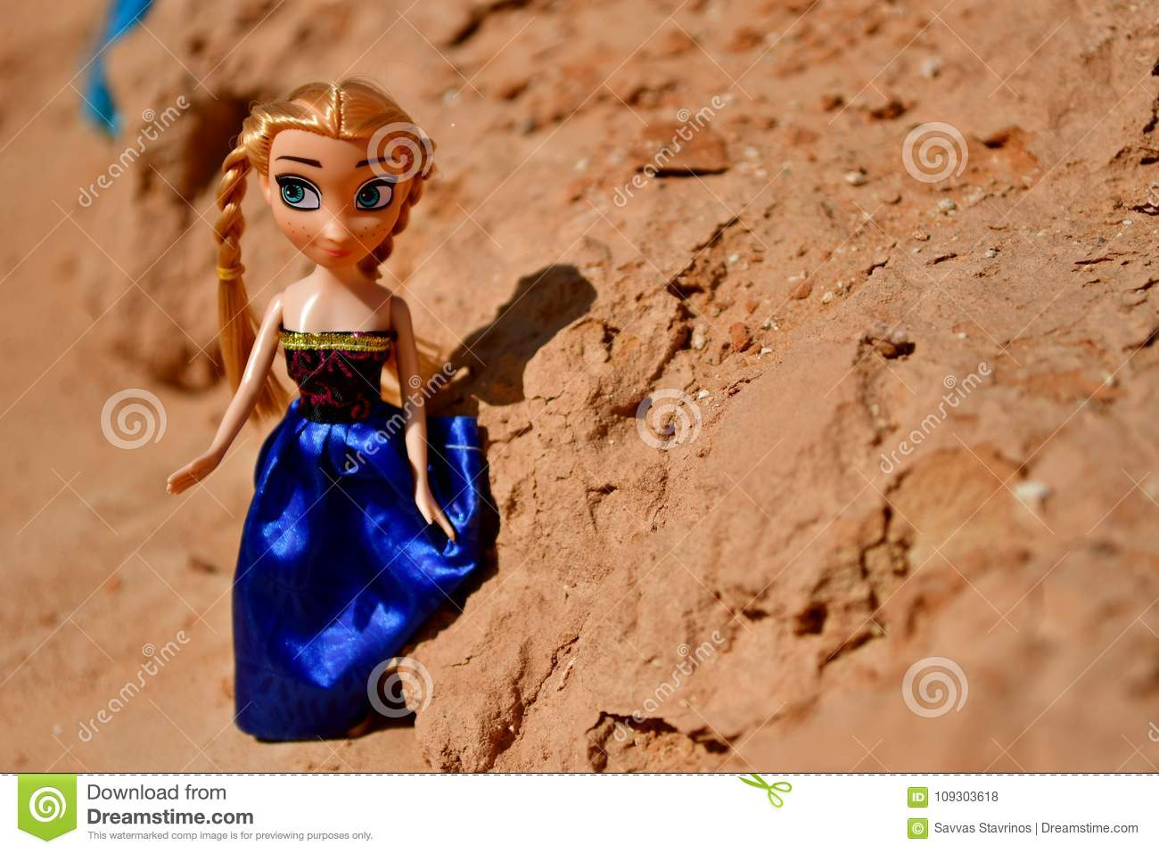 Blonde Dolls are playing in sand and walking together in a rocky area