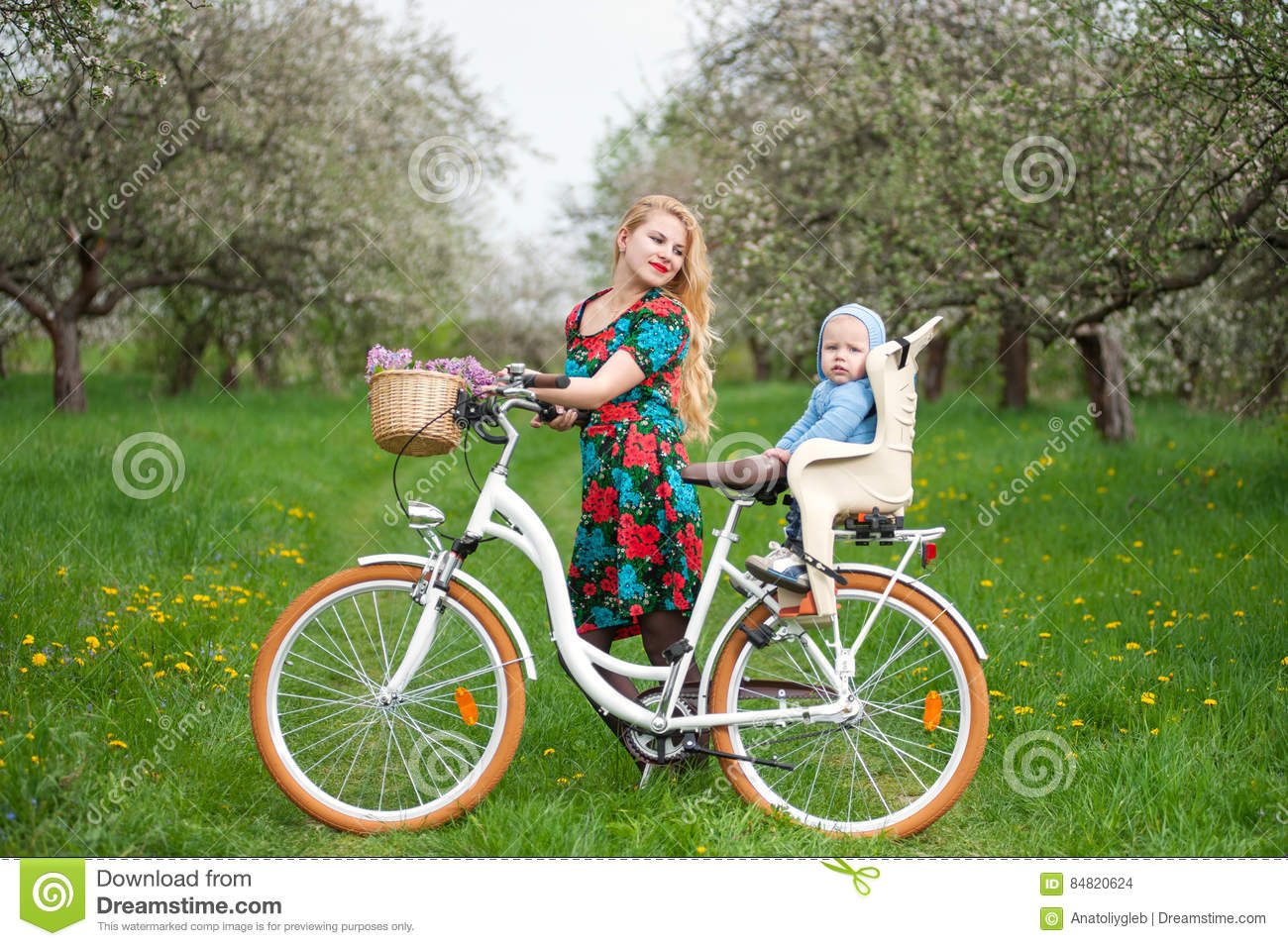 Blonde Female With City Bicycle With Baby In Bicycle Chair Stock