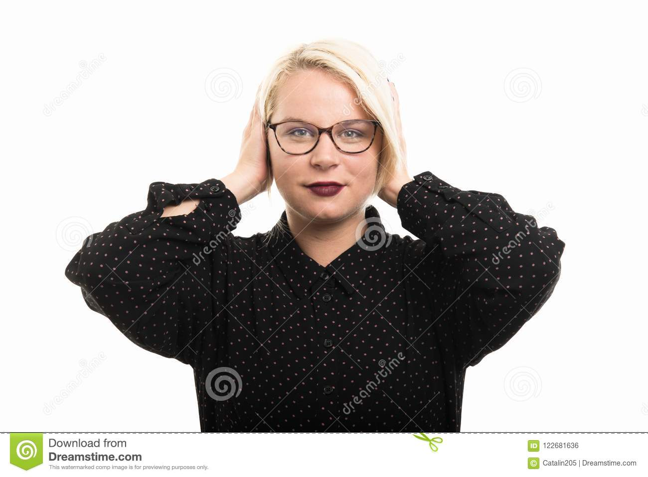 Blonde female teacher wearing glasses covering ears like deaf ge