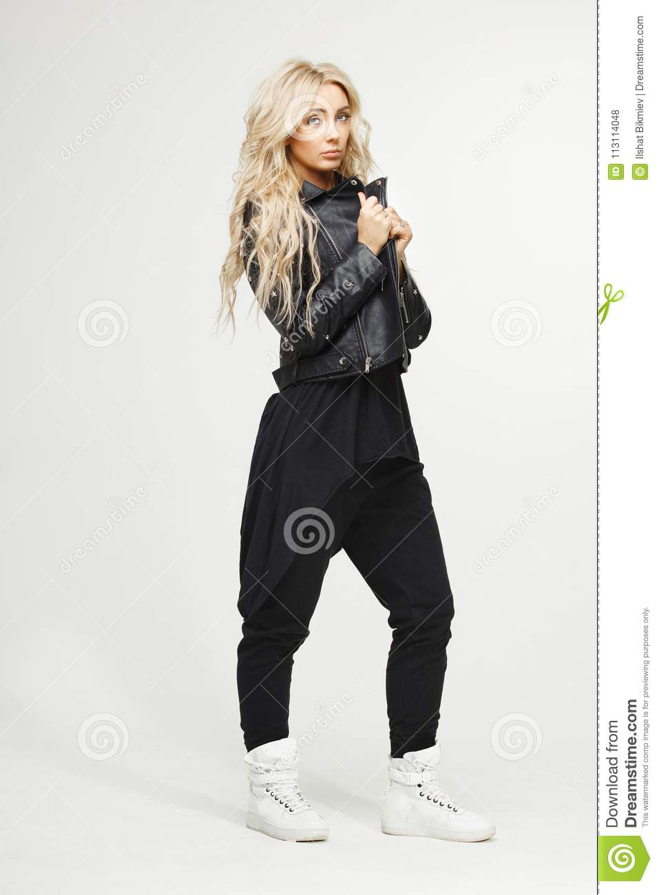 Blonde Girl In Black Jacket And Long T,shirt With Jeans On