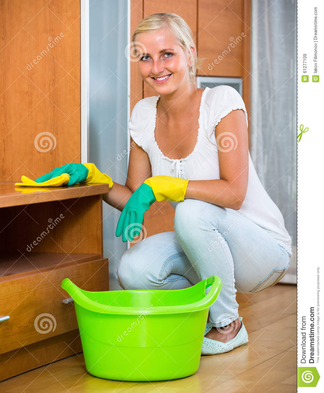 Blonde Girl Dusting In Living Room Stock Image Image
