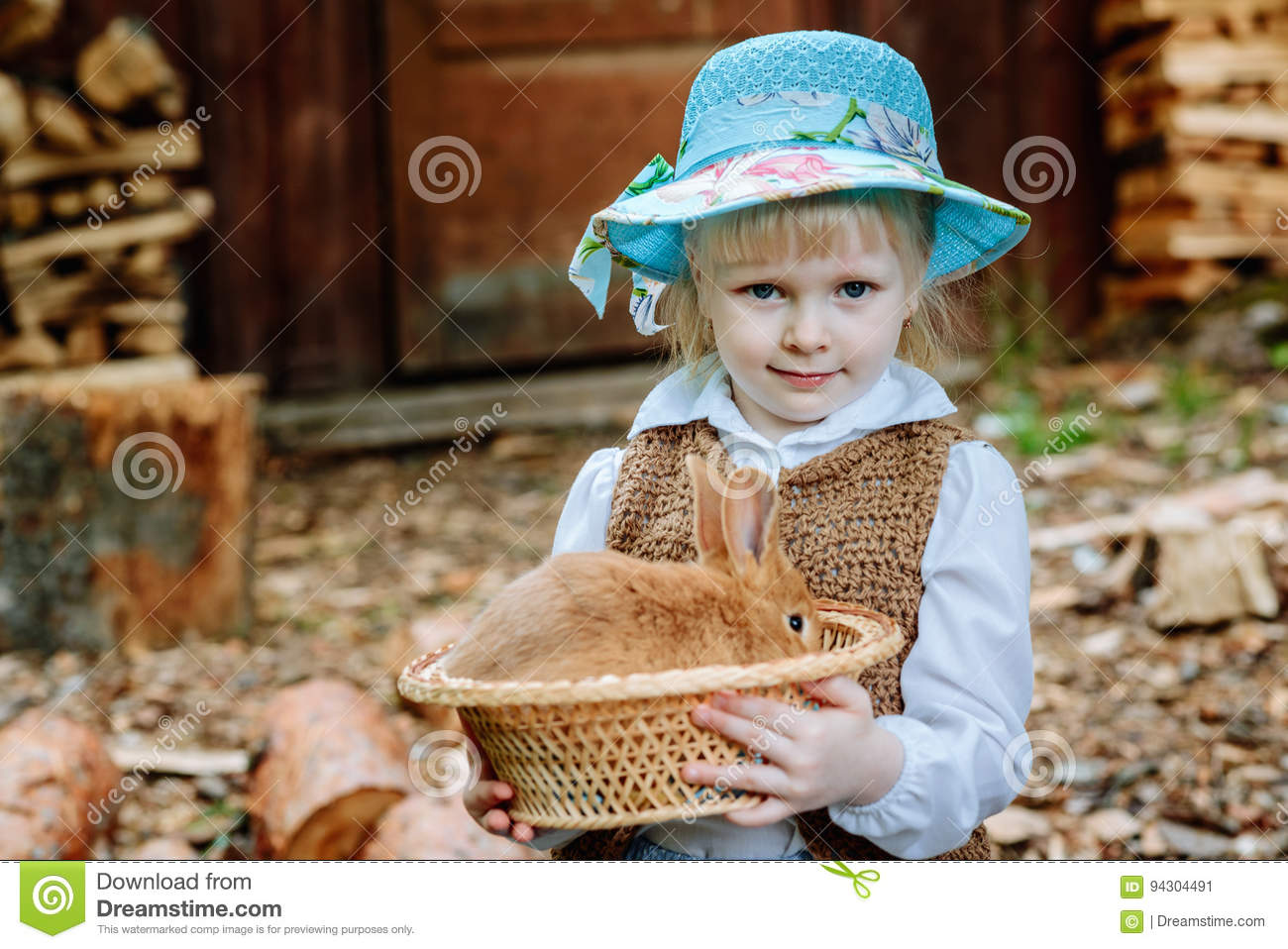 Blonde Girl In The Hat Holding A Rabbit Stock Image - Image of color ... 911dd2469ff5