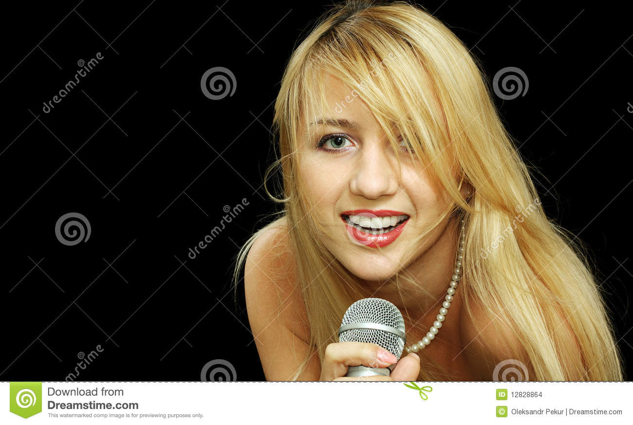 Portrait Blonde Girl With Naked Shoulders Singing Microphone