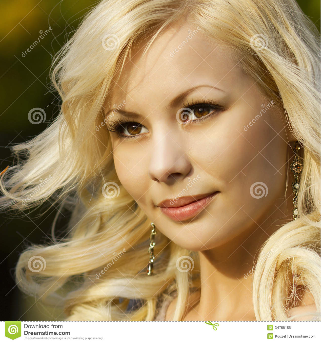 Blonde girl. Portrait of Beautiful Smiling Happy Young Woman Outside.