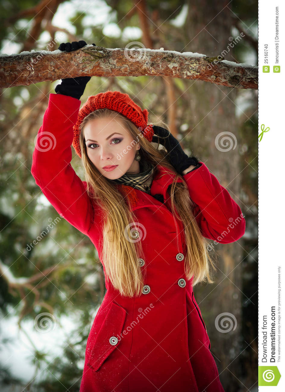 9dd4b0136 Blonde Girl With Red Coat In Winter Snow Stock Photo - Image of ...