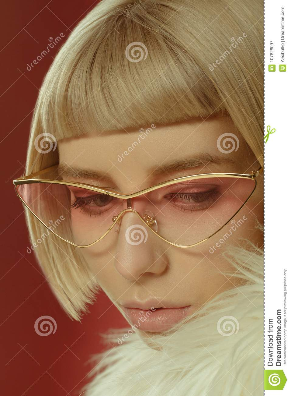 fa4a79fd6b72 Beautiful portrait of a stylish girl in fashionable glasses on a white  background
