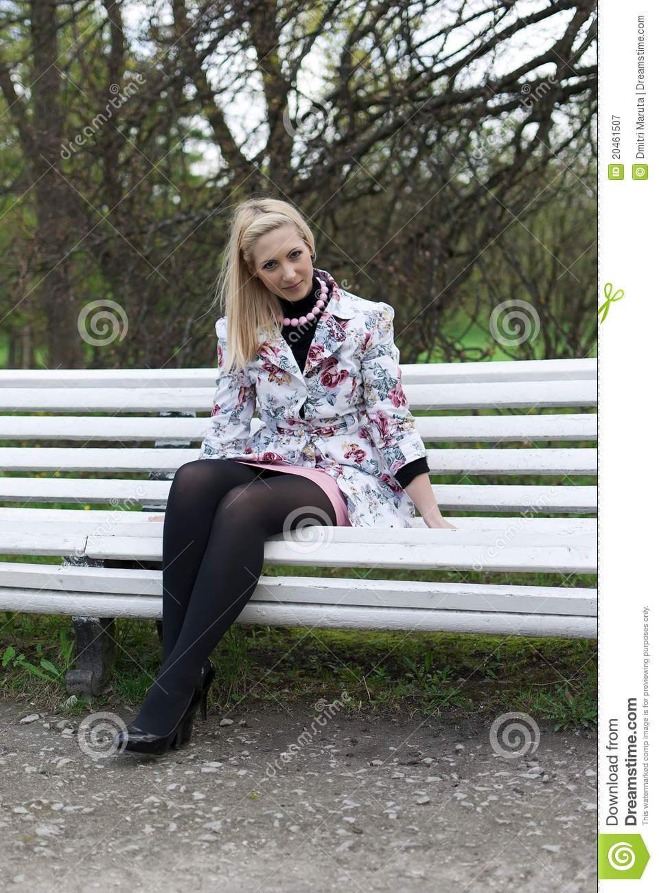 Blonde Girl Sitting On A Park Bench Stock Image - Image