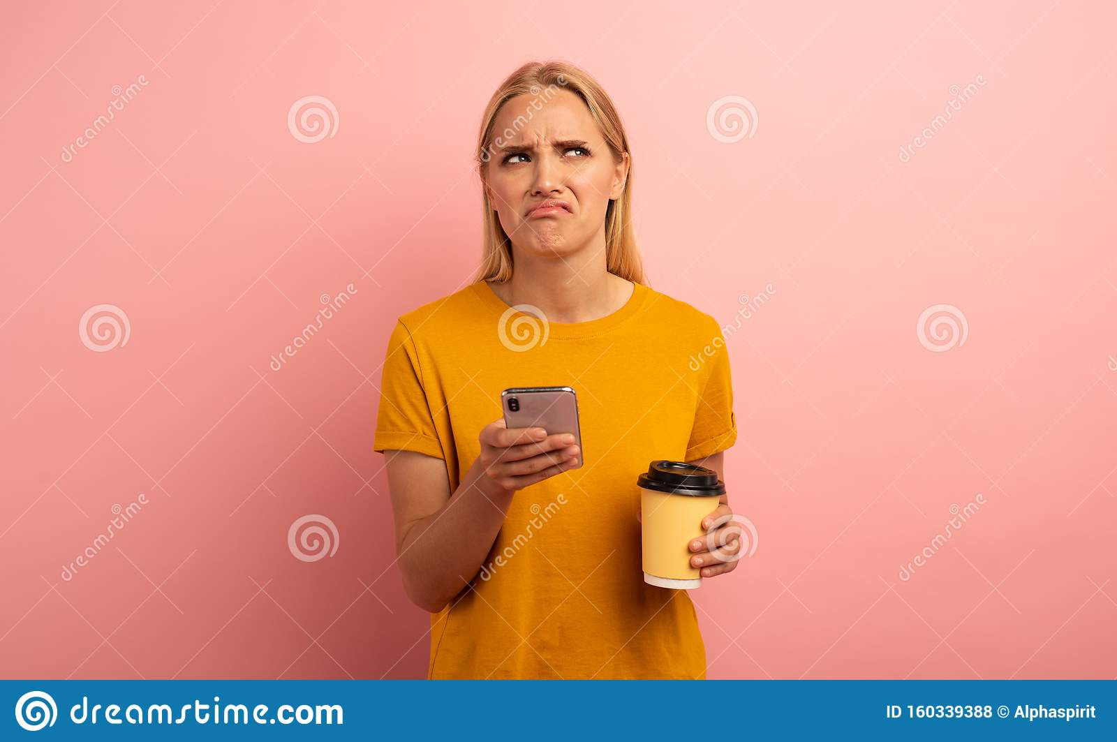 Blonde girl thinks about the right option. Yes or no. Confused and pensive expression. Pink background