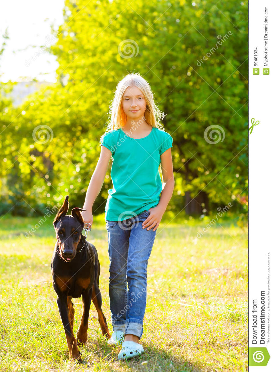 Girl Playing With Dog In Park