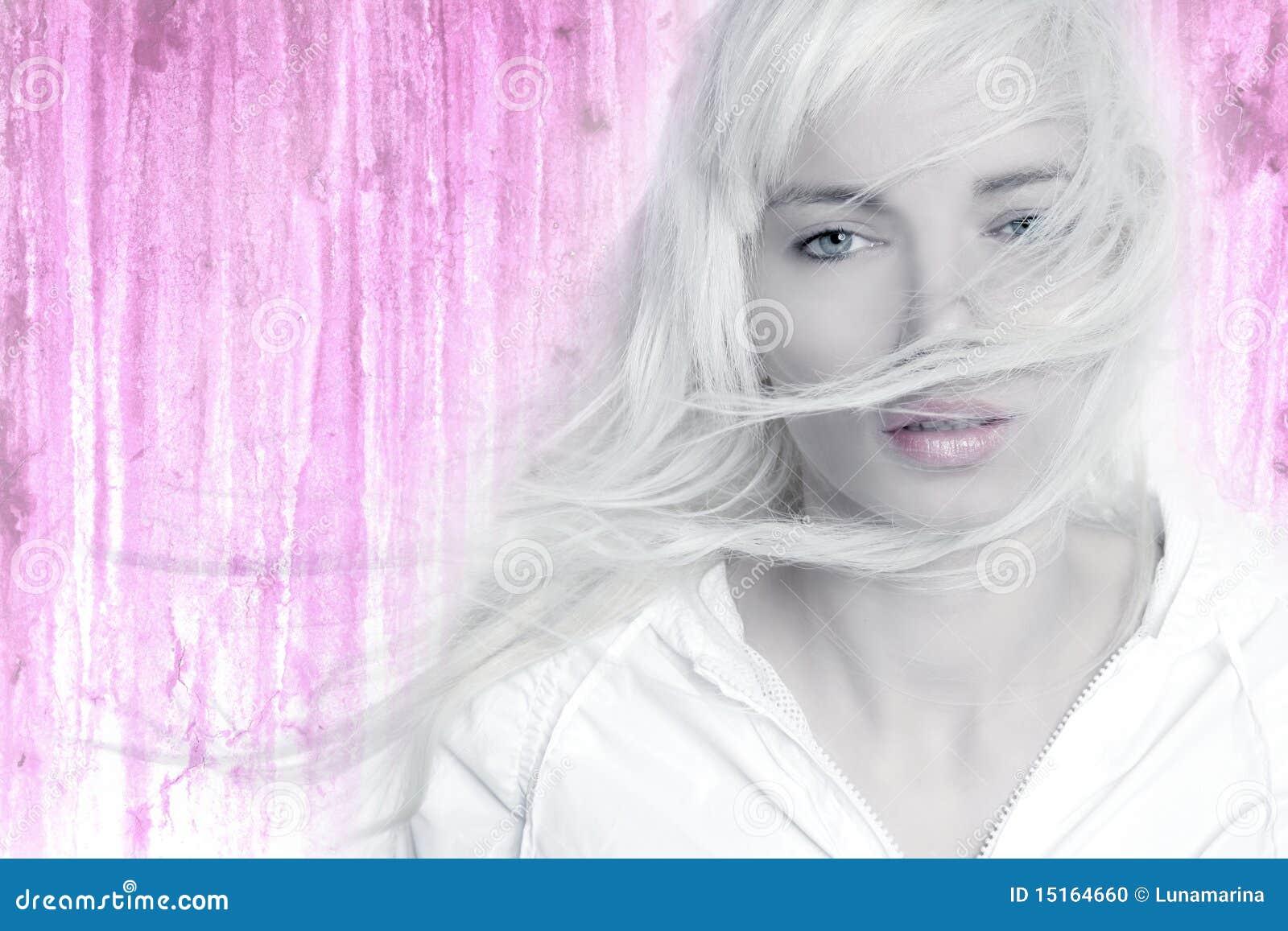 Blonde girl wind long hair flying pink