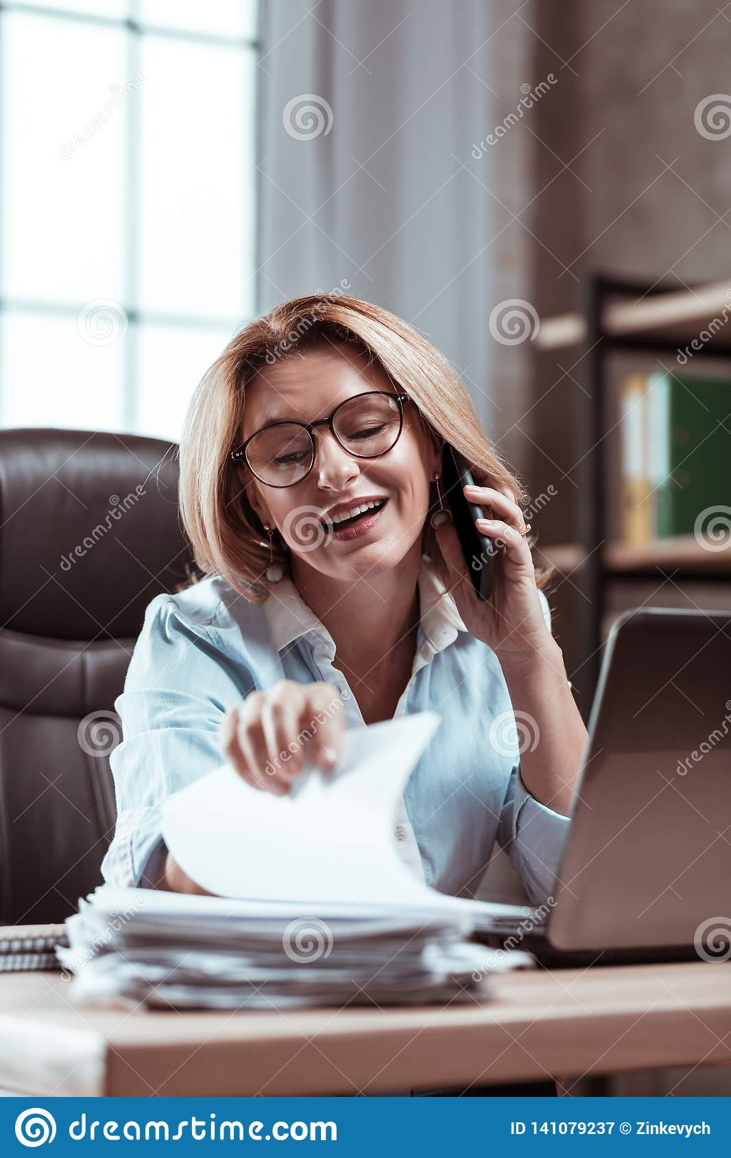 Blonde-haired businesswoman searching some important work documents