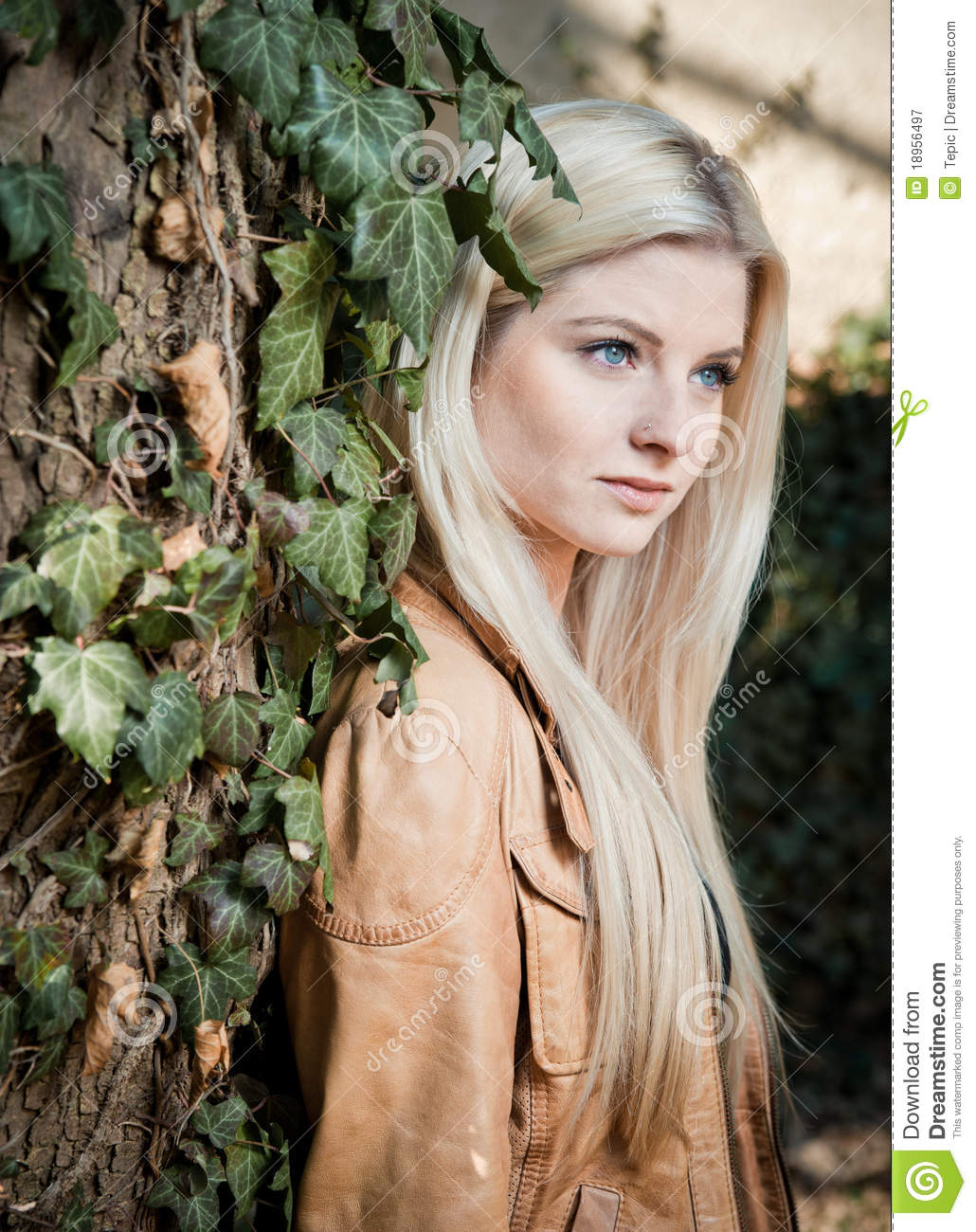 Blonde leaning on Tree