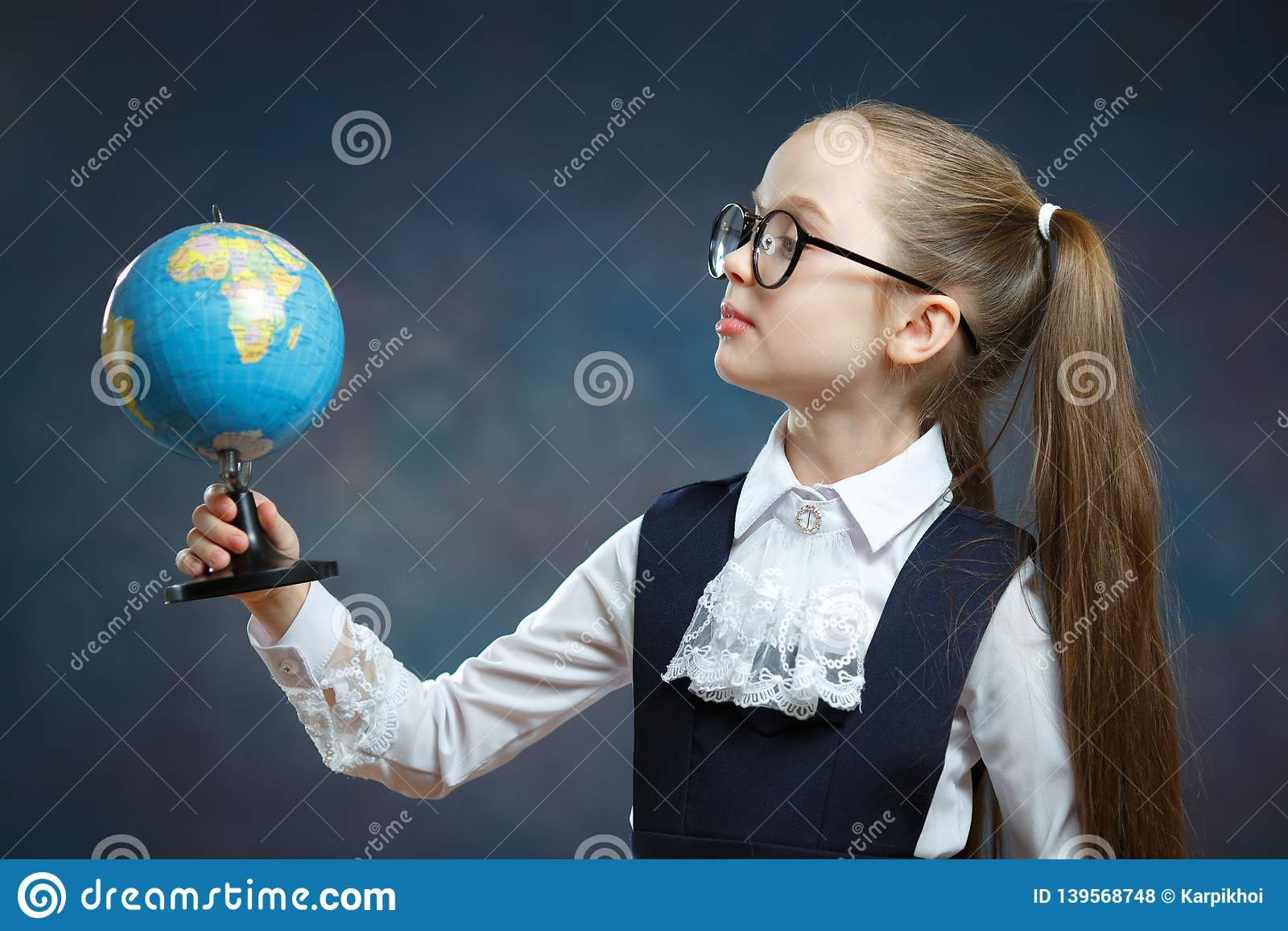 Blonde Little Schoolgirl Hold World Globe in Hand
