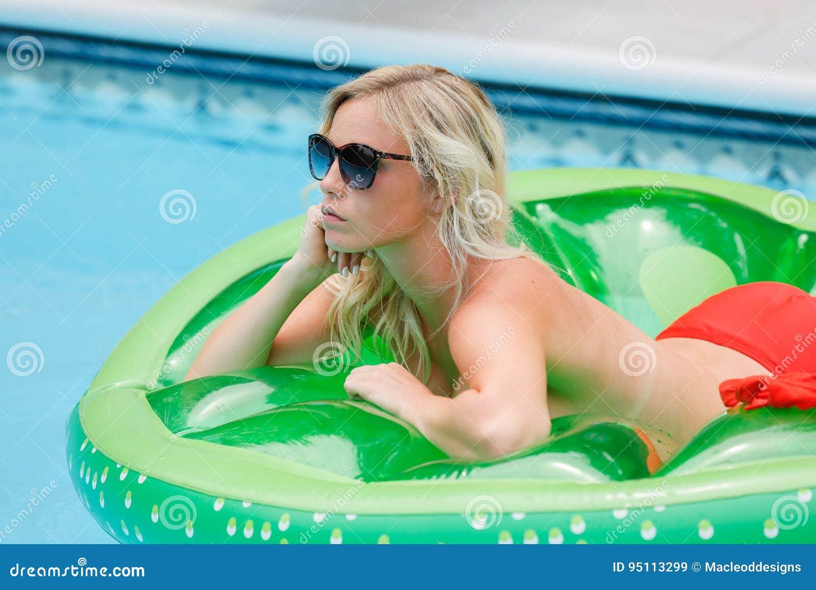 Blonde in pool