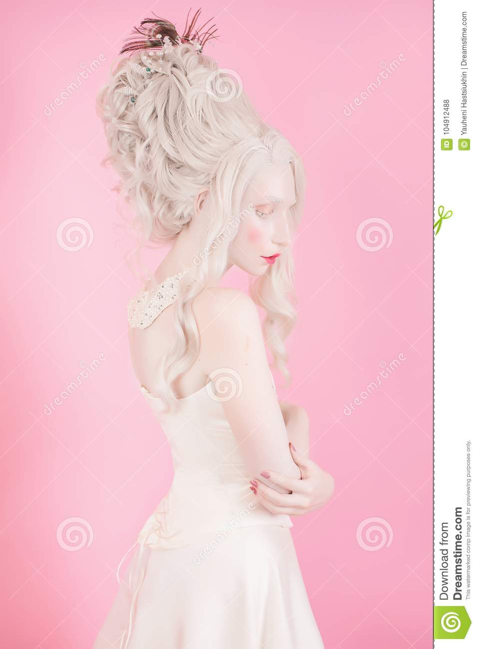 Blonde woman with beautiful luxurious rococo hair style