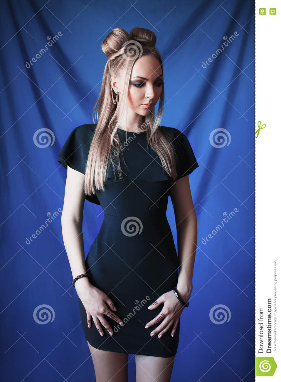 Woman With Blond Hair Blue Eyes Green Background Royalty