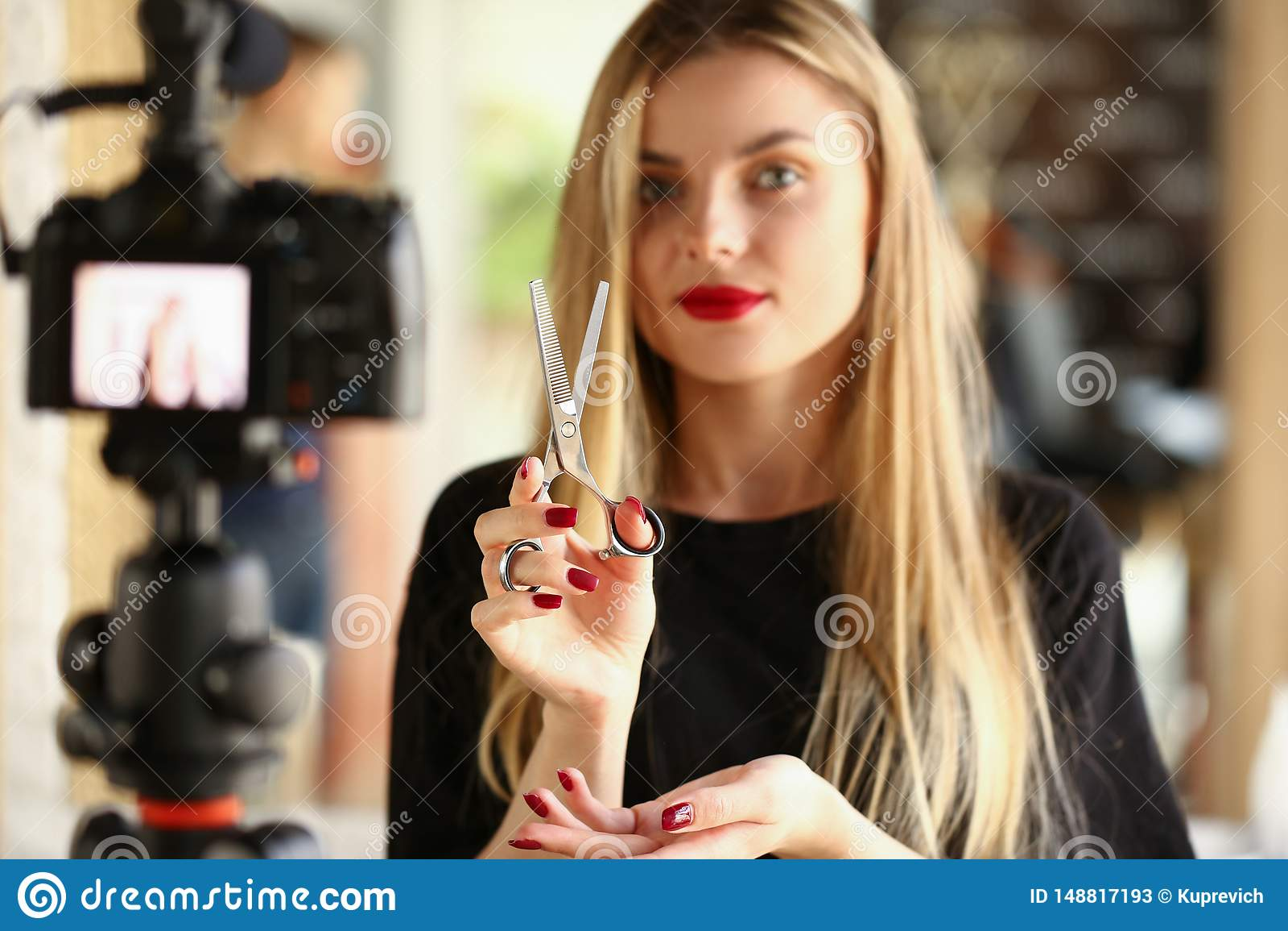 Blonde Woman Blogger Holding Metallic Scissors