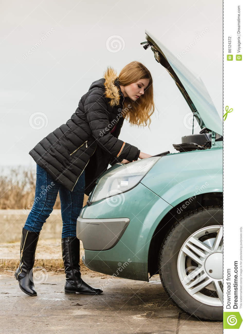 Blonde Woman And Broken Down Car On Road Stock Photo - Image of ...