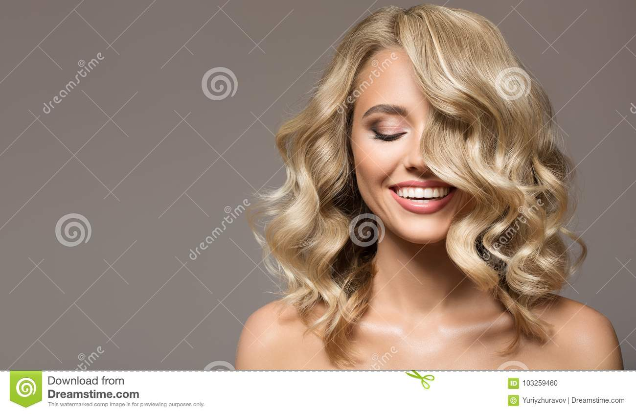 Blonde woman with curly beautiful hair smiling