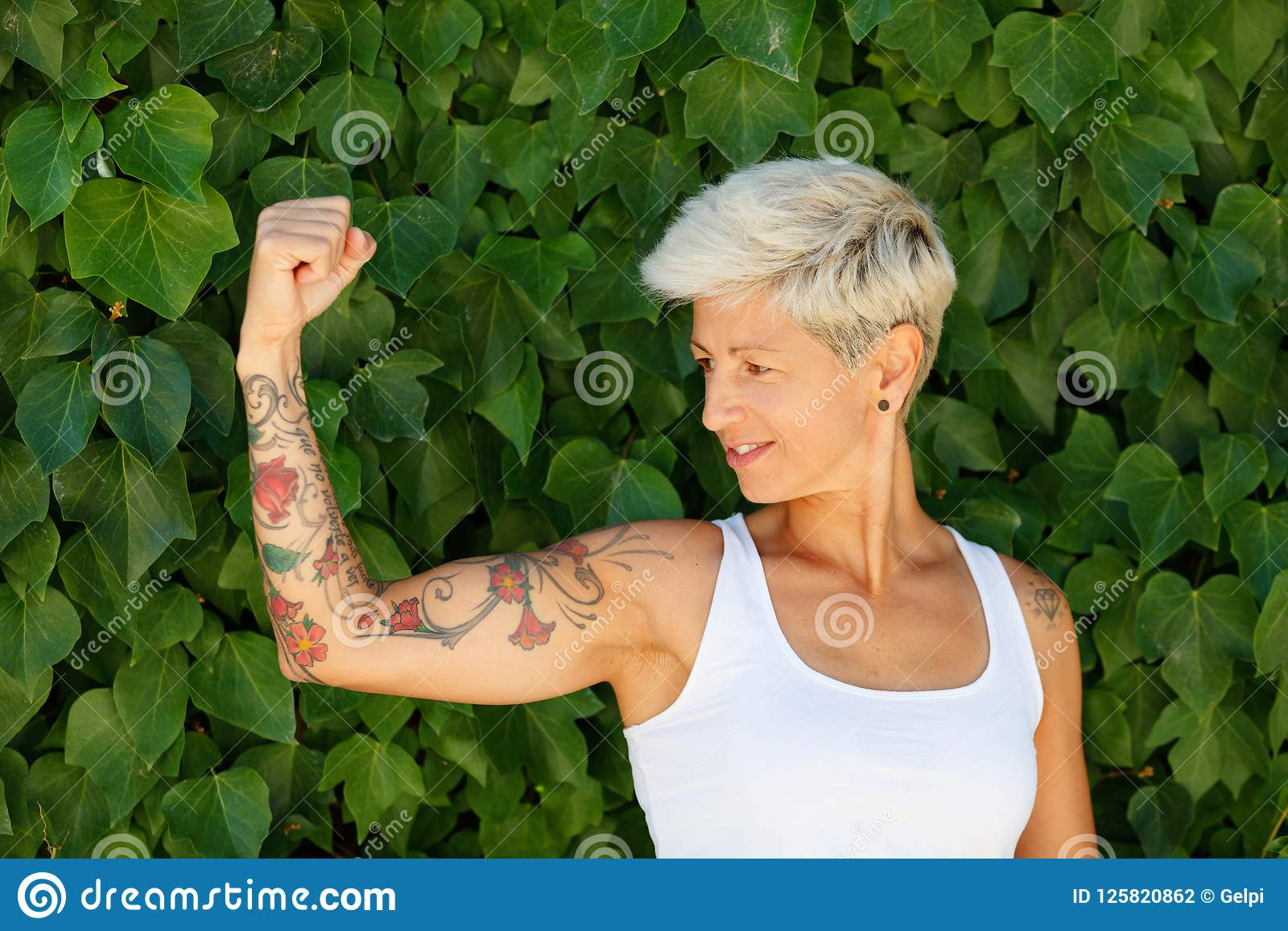 Woman with flowered tattoos on her arm