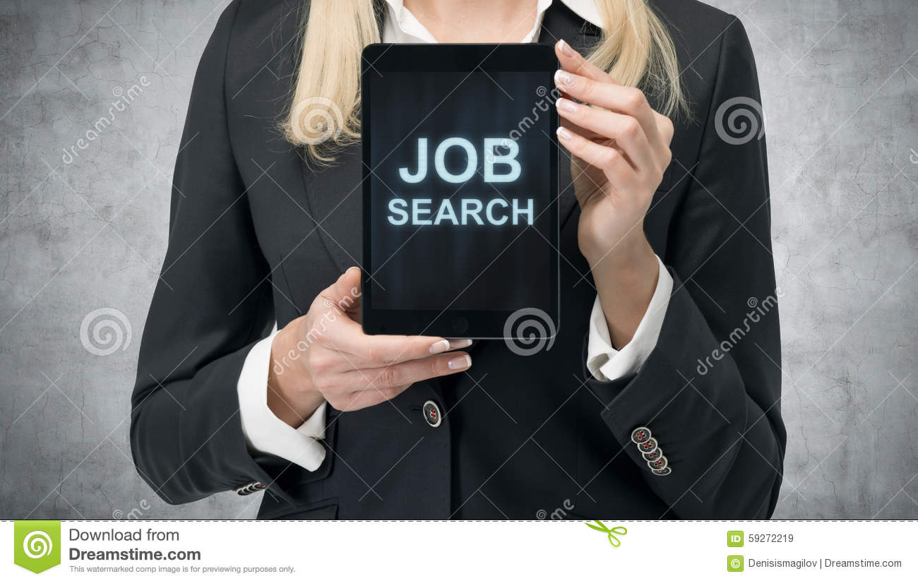Blonde woman in formal suit presents a tablet with the words  Job Search  on the screen. A concept of recruitment process. Interns