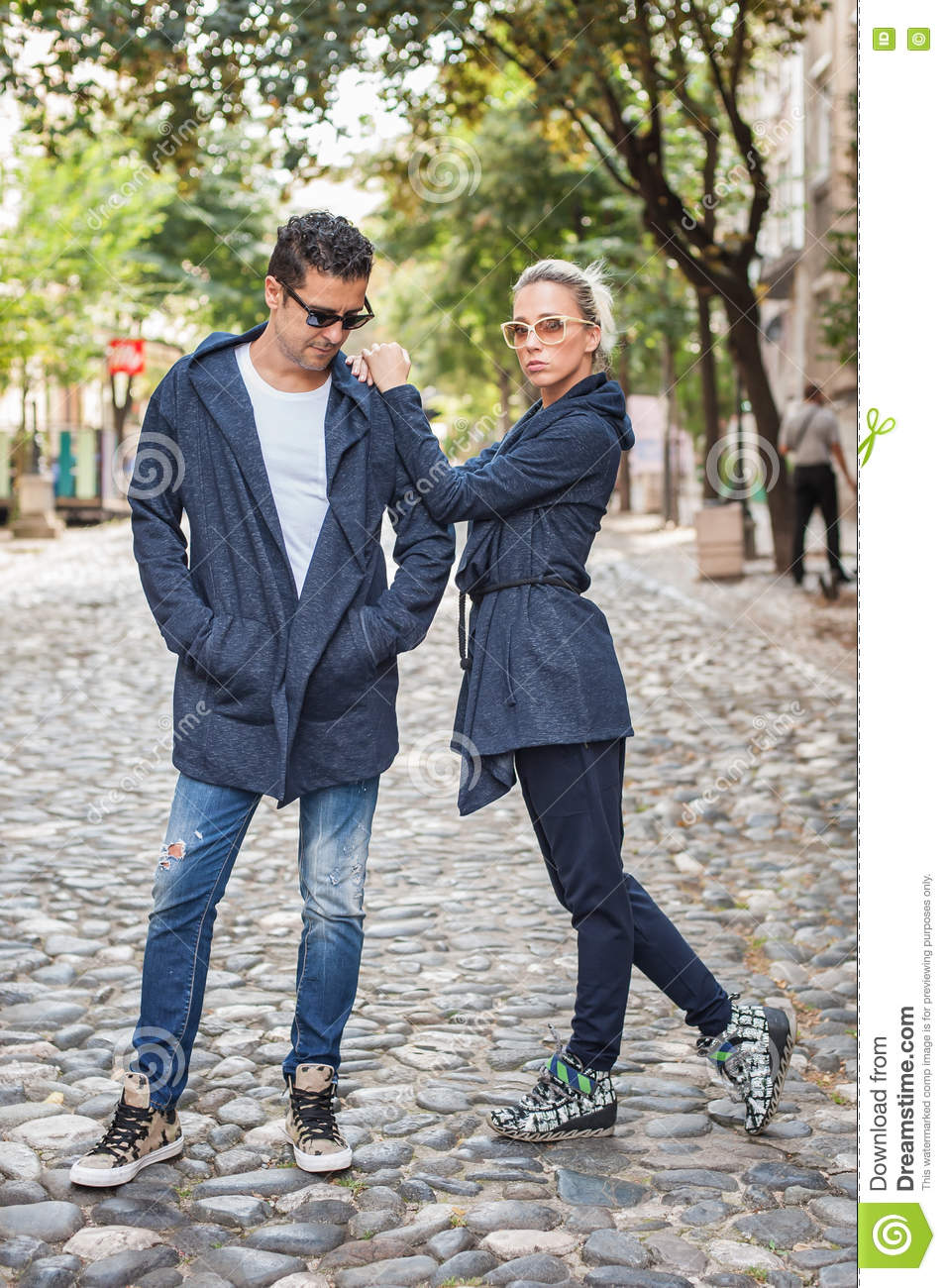 Blonde Woman And Handsome Man Posing On The Street Stock Photo