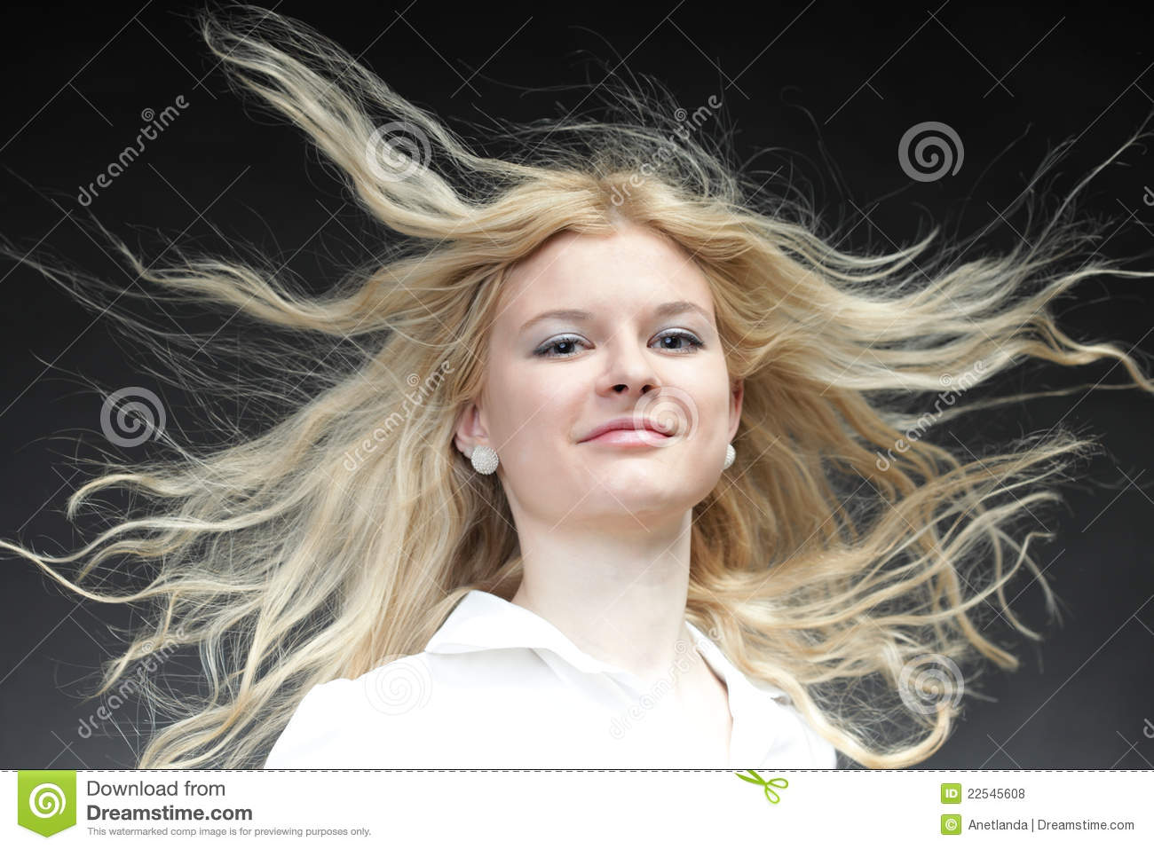 Blonde Woman With Her Hair Blowing Royalty Free Stock