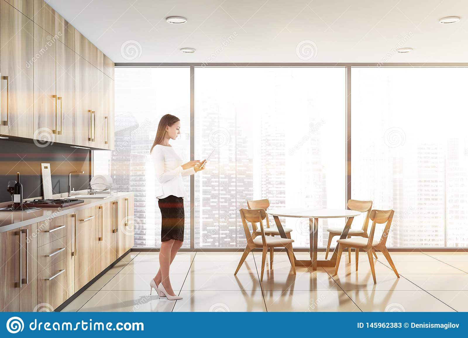 Blonde woman in panoramic kitchen