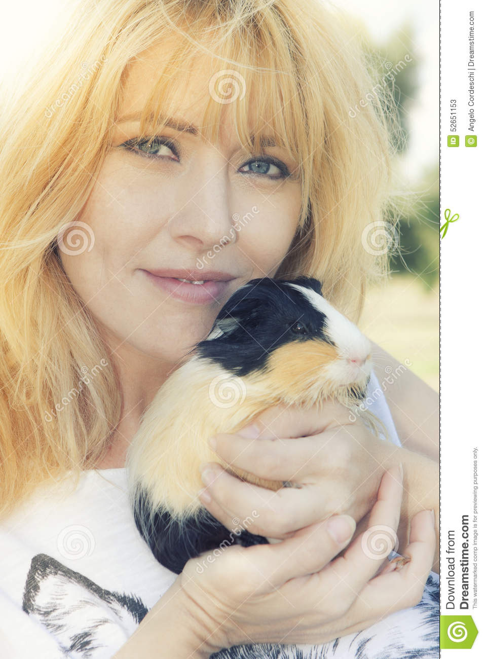 Blonde woman with Peruvian guinea pig