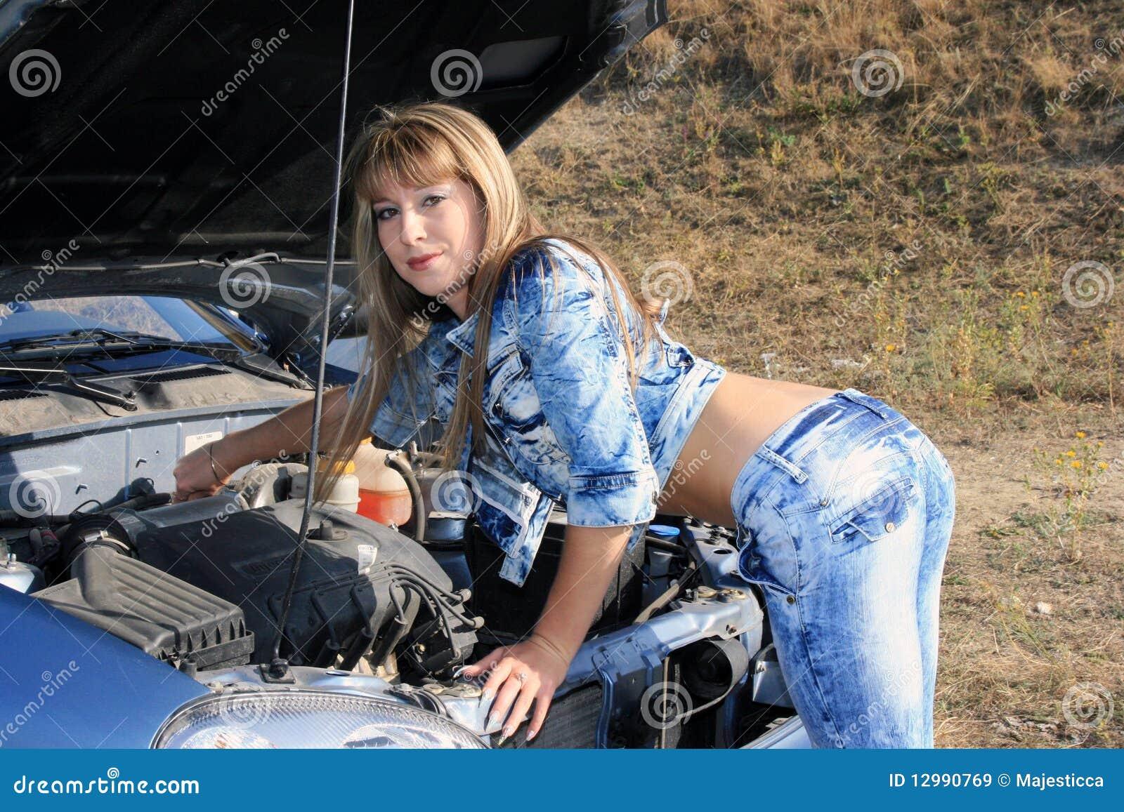 Blonde woman repairs car motor royalty free stock images for Motor vehicle repair license