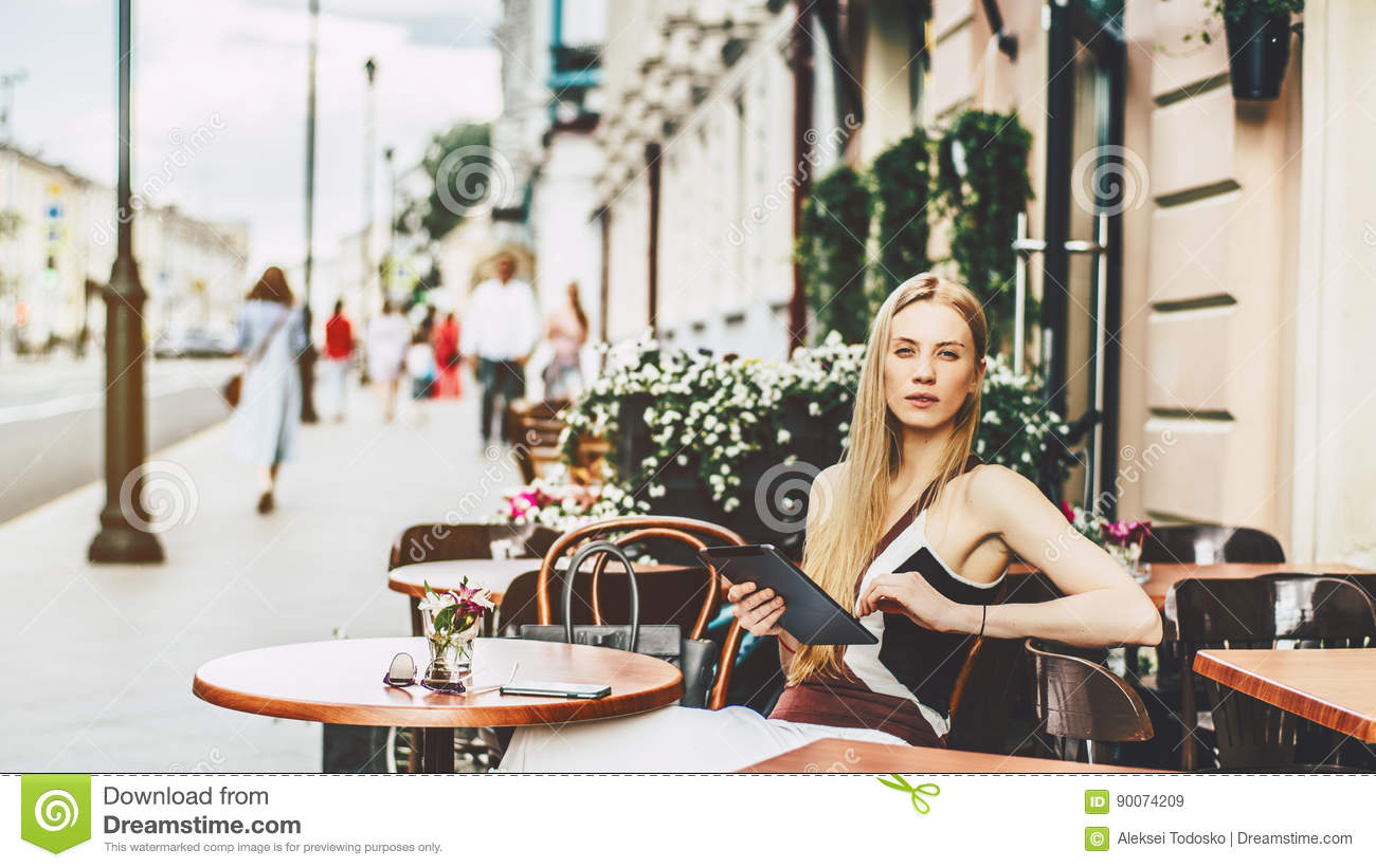 Blonde Woman In Street Bar With Digital Tablet Stock Image ...