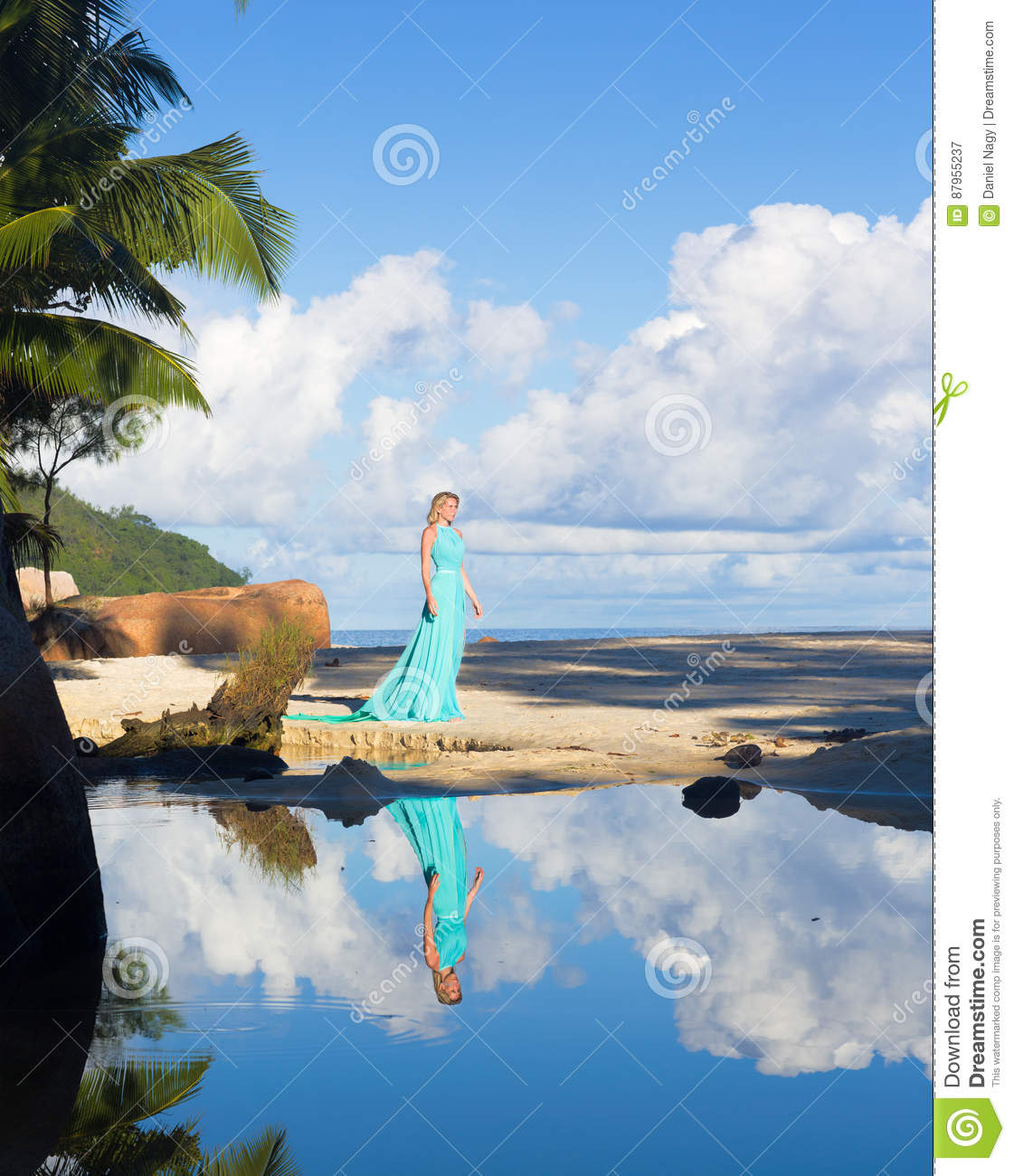Blonde Woman In Turquoise Long Dress At The Beach