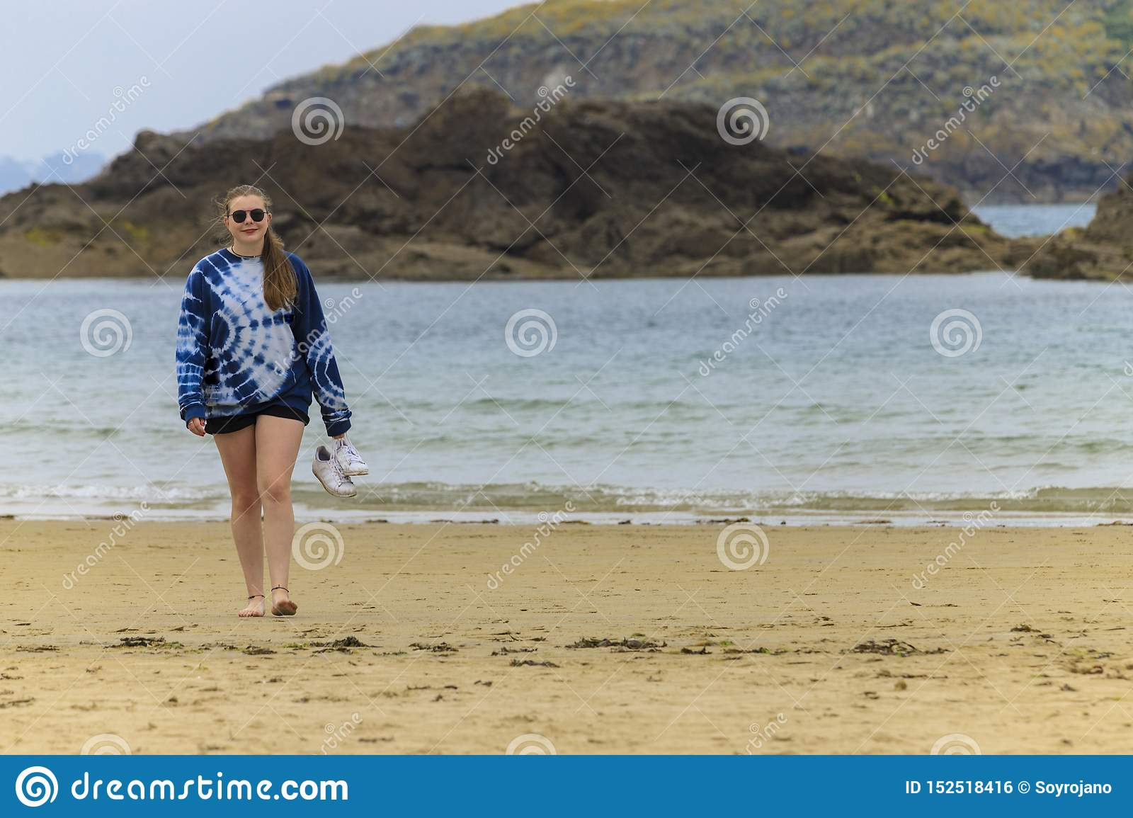 Blonde young girl on the seashore