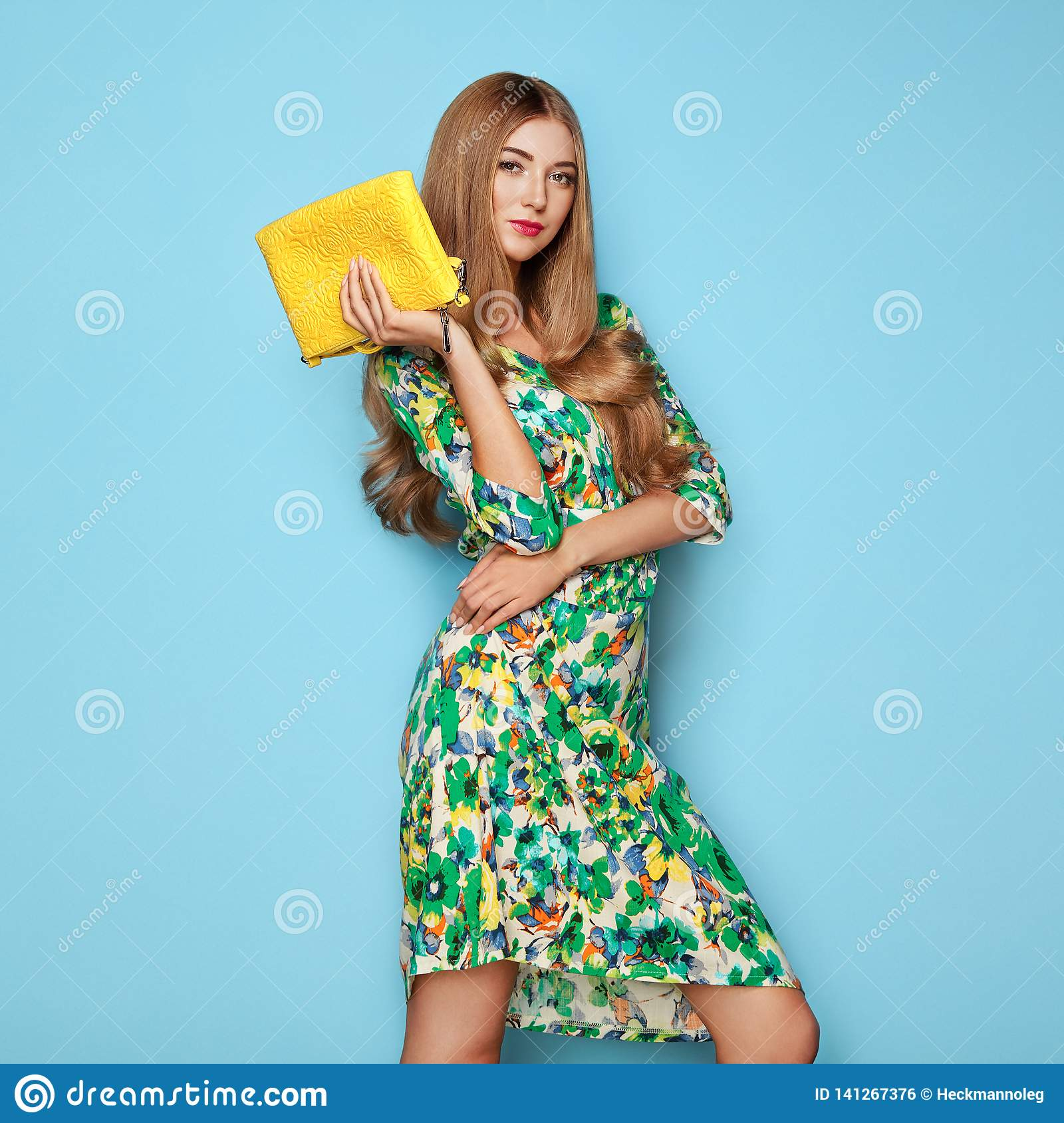 Blonde young woman in floral spring summer dress