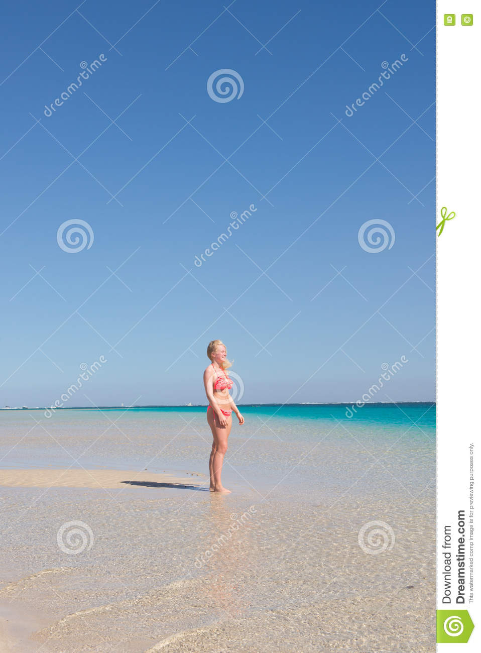 Blonde young woman paradise beach