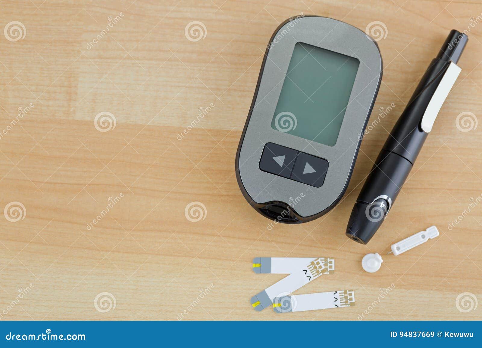 Blood Glucose Meter, Test Strip, Lancing Pen Device On
