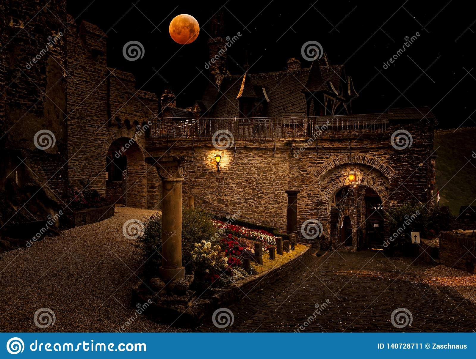 Blood moon over medieval city.