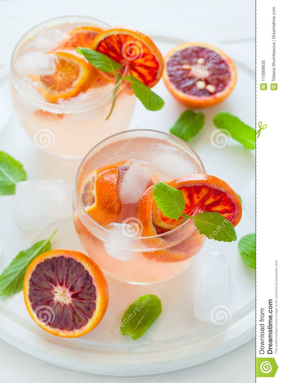 Blood orange cocktail with slices of orange
