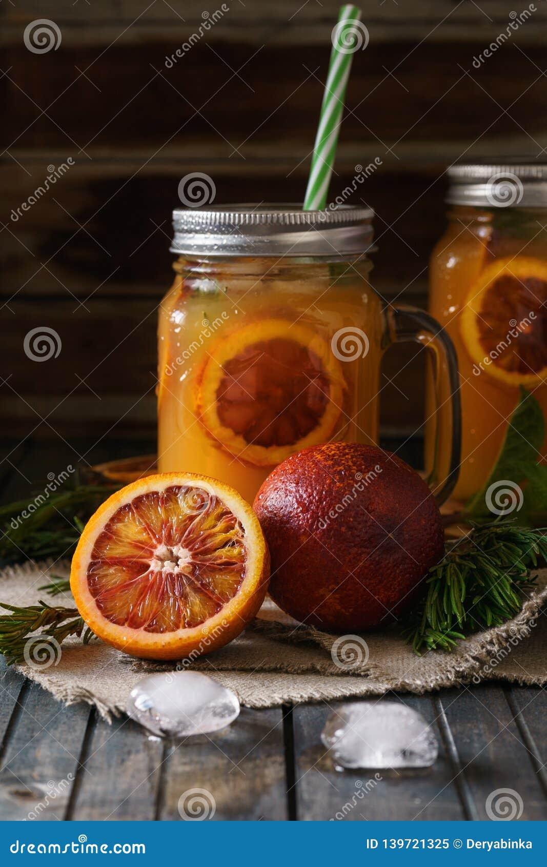 Blood orange juice with ice and orange slice