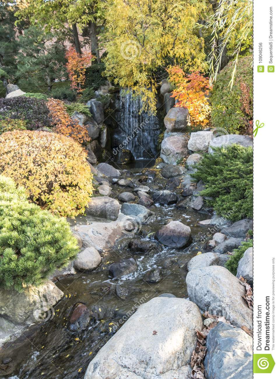 Bloomington, MN/USA - October 22, 2016: A beautiful waterfall and stream at the Japanese Garden at Normandale Community College in Bloomington, Minnesota.