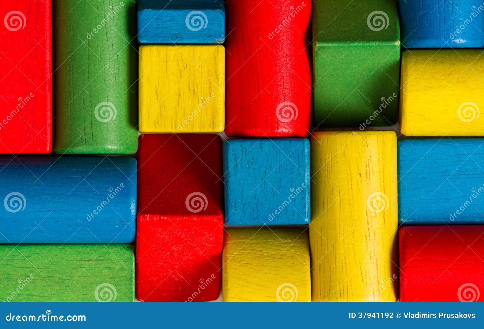 Bloques de los juguetes, ladrillos de madera multicolores, grupo de buildin colorido