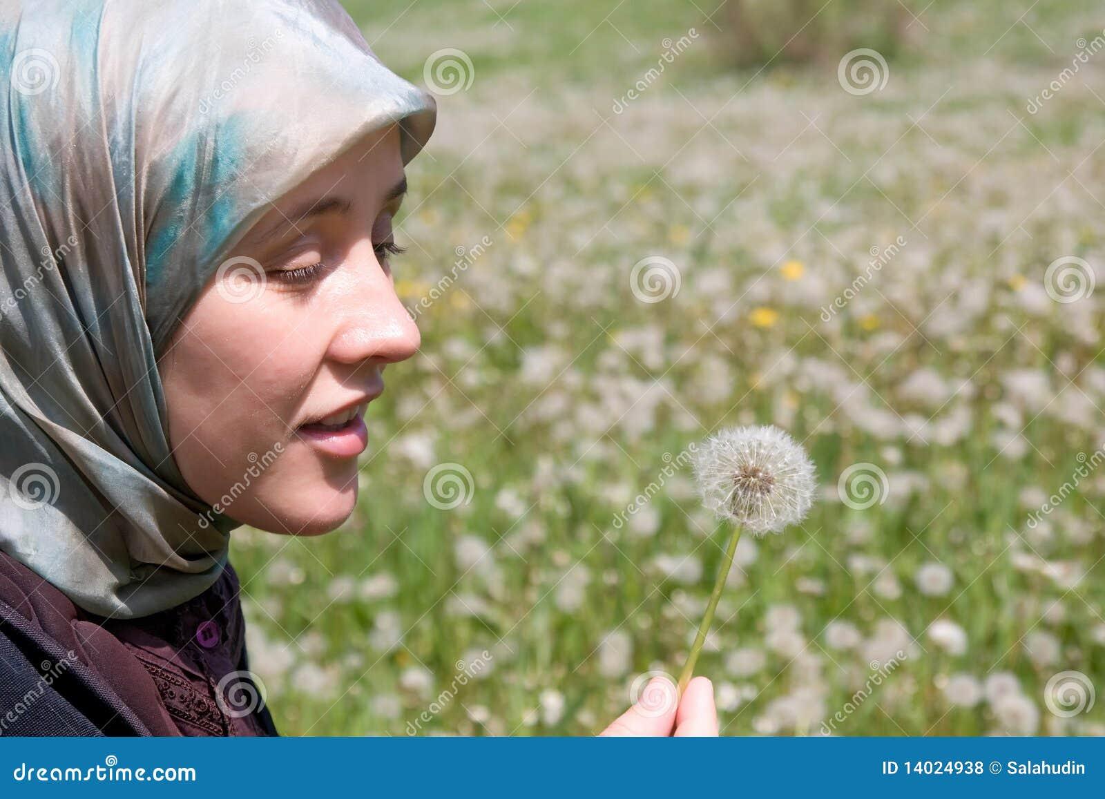 Blowball de la mujer y del diente de león del Islam