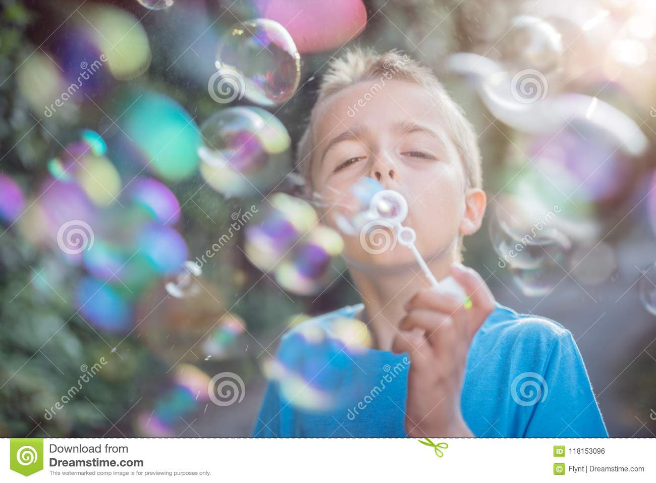 Blowing soap bubbles in the summer sun
