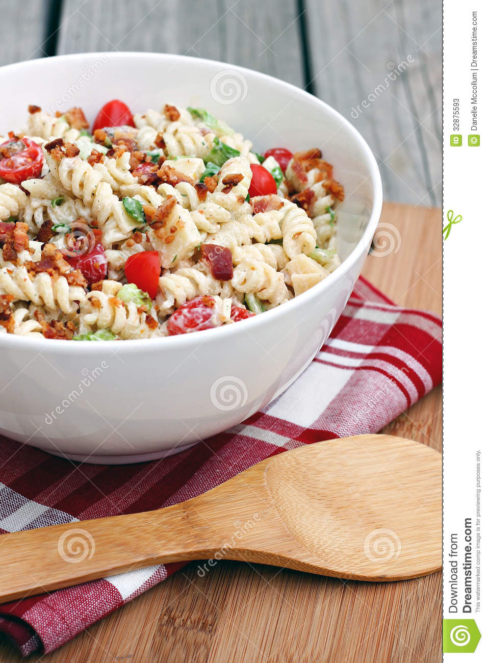 Pasta salad with bacon, lettuce and tomato.