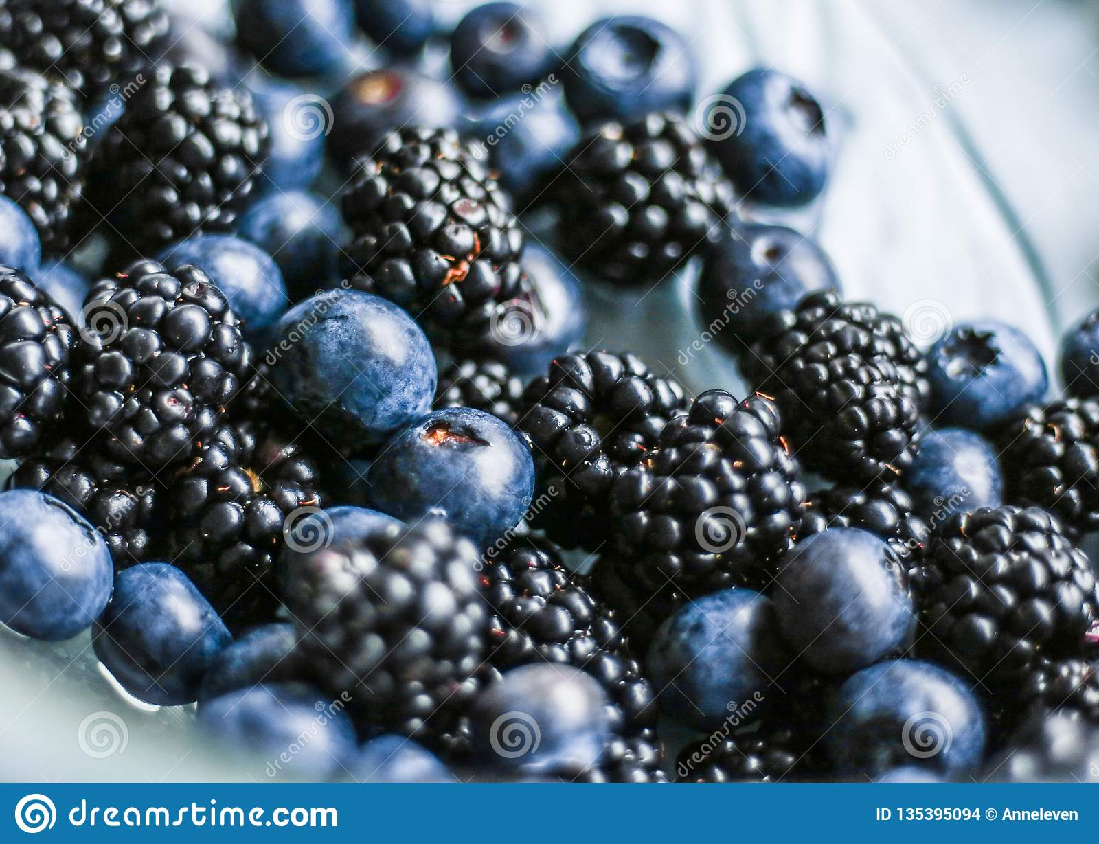 bluberries and blackberries - fresh fruits and healthy eating styled concept