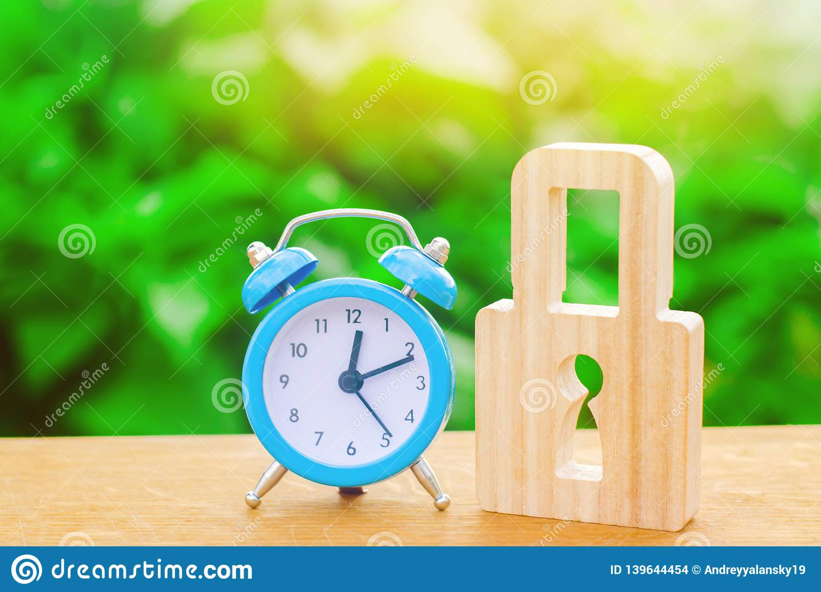 Blue alarm clock and padlock. Non-durable protection time-tested protection and stability. Saving time. The concept of a temporary