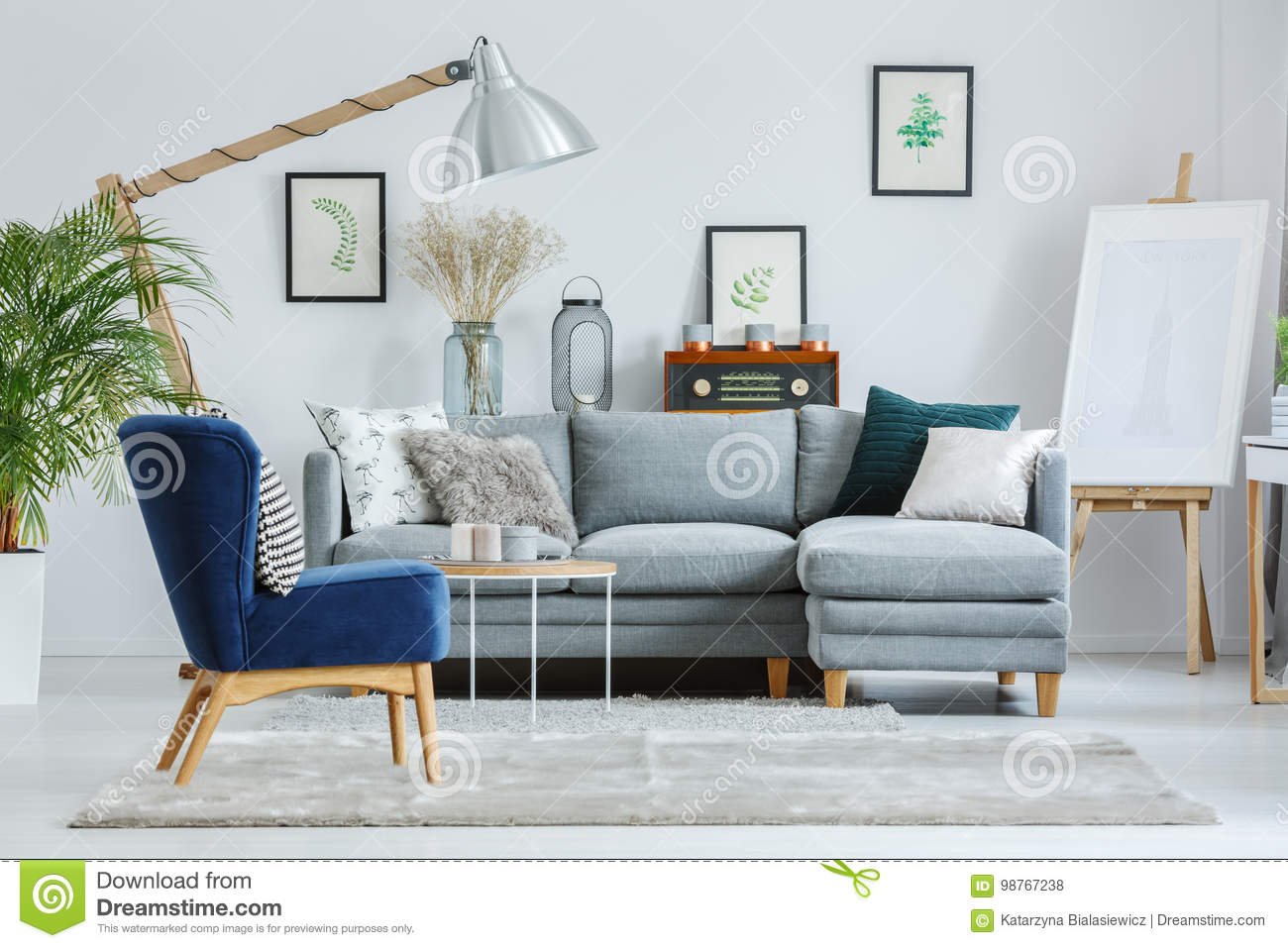 Awesome Blue Armchair On Grey Carpet Stock Photo Image Of Light Machost Co Dining Chair Design Ideas Machostcouk